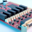 Electronic board - red PCI card - Stock Photo