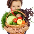 Foto Stock: Little boy with basket of vegetables
