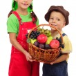 Two little children with basket of fruits — Stock Photo