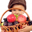 Little boy with basket of fruits - Stock Photo