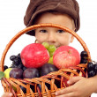 Little boy with basket of fruits — Stock Photo