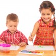Smiling little children with watercolor paintings — Stock Photo #4886679