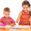 Smiling little children with watercolor paintings — Stock Photo
