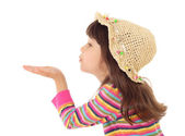 Little girl blows with an empty hand — Stock Photo