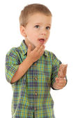 Pensive little boy with chocolate ice cream — Stock Photo