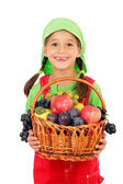 Little girl with basket of fruits — Stock Photo