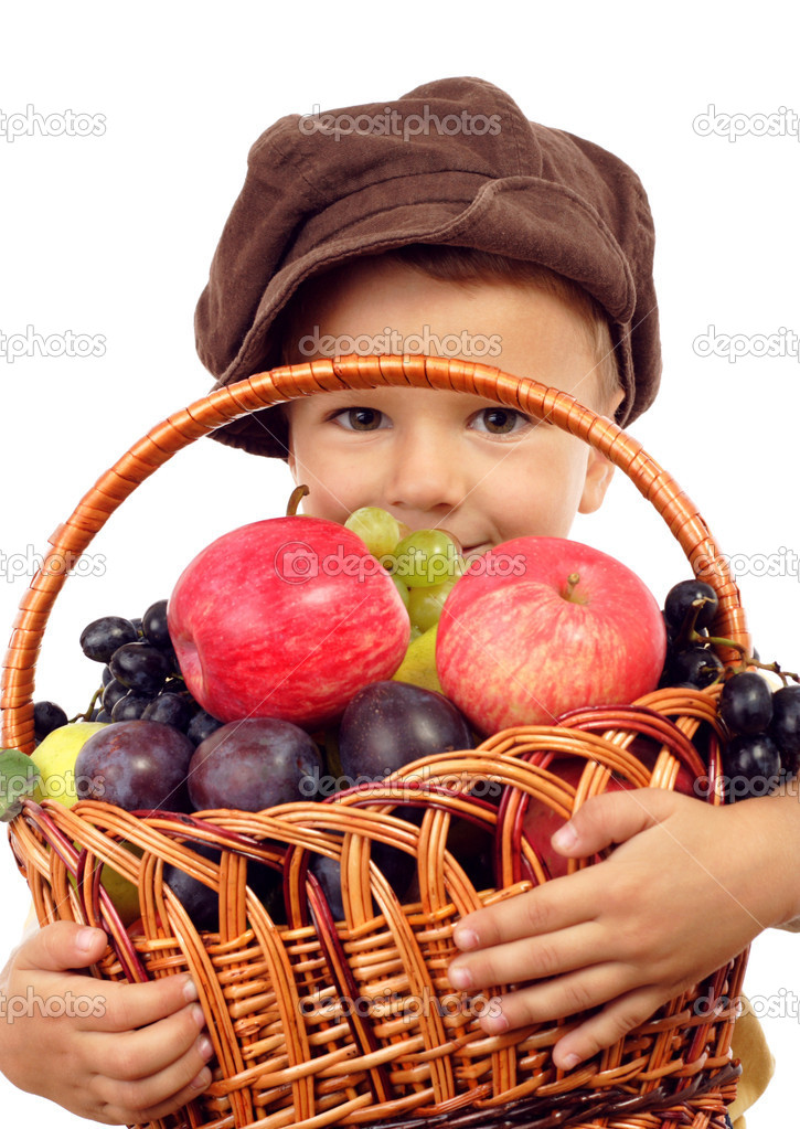 Little boy with basket of fruits, isolated on white  Stock Photo #4886494