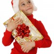 Dreaming little girl with yellow Christmas gift box — Stock Photo