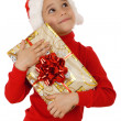 Dreaming little girl with yellow Christmas gift box — Stock Photo #4924047