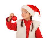 Niña en sombrero de la navidad con la bola de la decoración — Foto de Stock