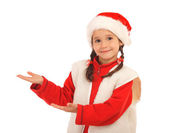 Little girl in Christmas hat with an empty hands — Stock Photo