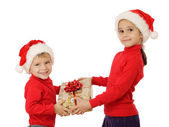 Smiling little children with yellow Christmas gift box — Stock Photo