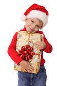Glimlachend jongetje met gele doos van de gift van kerstmis — Stockfoto