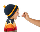 Little open-mouthed boy in the sweater with spoon — Stock Photo