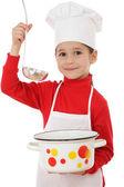 Usmívající se malý náčelník vařič s naběračkou a pot — Stock fotografie