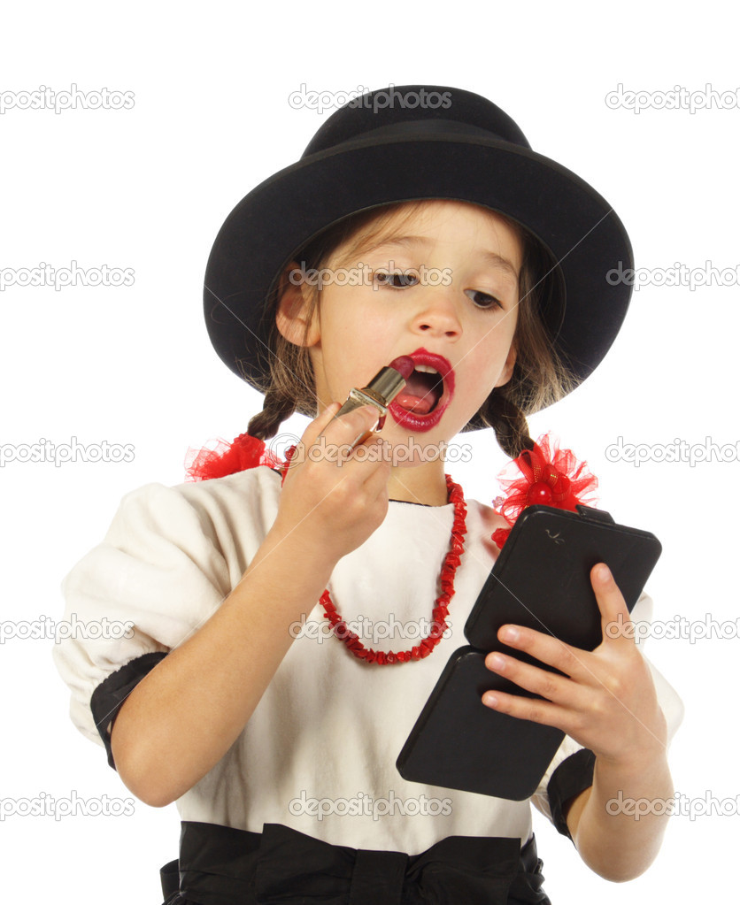 Little girl with red lipstick stock image