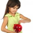 Little girl with red piggy bank — Stock Photo