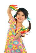Liten flicka med målade händer — Stockfoto