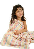 Smiling little girl in towel — Stock Photo