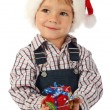 Smiling little boy with little Christmas gift box — Stock Photo