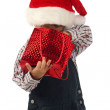 Smiling little boy with Christmas gift bag — Stock Photo