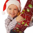 Smiling little boy with Christmas gift box — Stock Photo