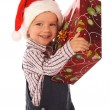 Smiling little boy with Christmas gift box — Stock Photo #4978347