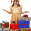 Smiling little girl with lot Christmas gift boxes — Stock Photo