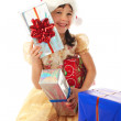 Smiling little girl with Christmas gift boxes — Stock Photo