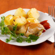 Stock Photo: Roasted chicken leg with potatoes on dish