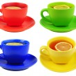 Set of 4 tea cups with lemon — Stock Photo