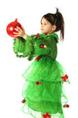 Little smiling girl with red Christmas decoration — Stock Photo