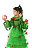 Little girl in green Christmas tree costume with Christmas decoration — Stock Photo