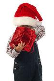 Smiling little boy with Christmas gift bag — Stockfoto