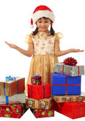 Smiling little girl with lot Christmas gift boxes — Stockfoto