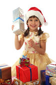 Uśmiechnięta dziewczynka z boże narodzenie prezentowe — Zdjęcie stockowe