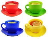 Set of 4 tea cups with lemon — Stock Photo