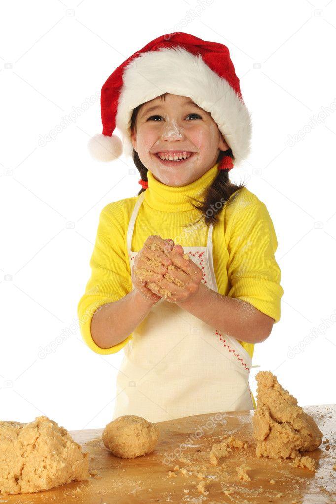 Ni a cocinando el pastel de navidad foto de stock - Nina cocinando ...
