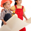 Two little builders planning with liquid level and blueprint — Stock Photo