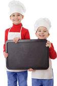 Little cookers with empty horizontal chalkboard — Stock Photo