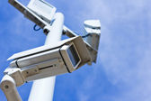 Surveillance camera from low angle — Stock Photo