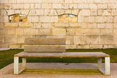 Wooden bench in a rock castle — Stock Photo