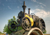 Old tractor on a pedestal — Stock Photo