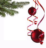 Christmas balls and paper streamer — Stock Photo