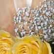 Yellow roses and glass of wine — Stock Photo