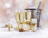 Glasses of champagne and gifts — Stock Photo