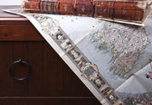 Old book and antique map — Stock Photo