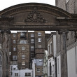 Antique arch between buildings — Stock Photo #5028299