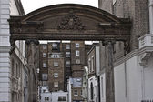 Antique arch between buildings — Stok fotoğraf