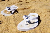 Thongs at beach — Stock Photo